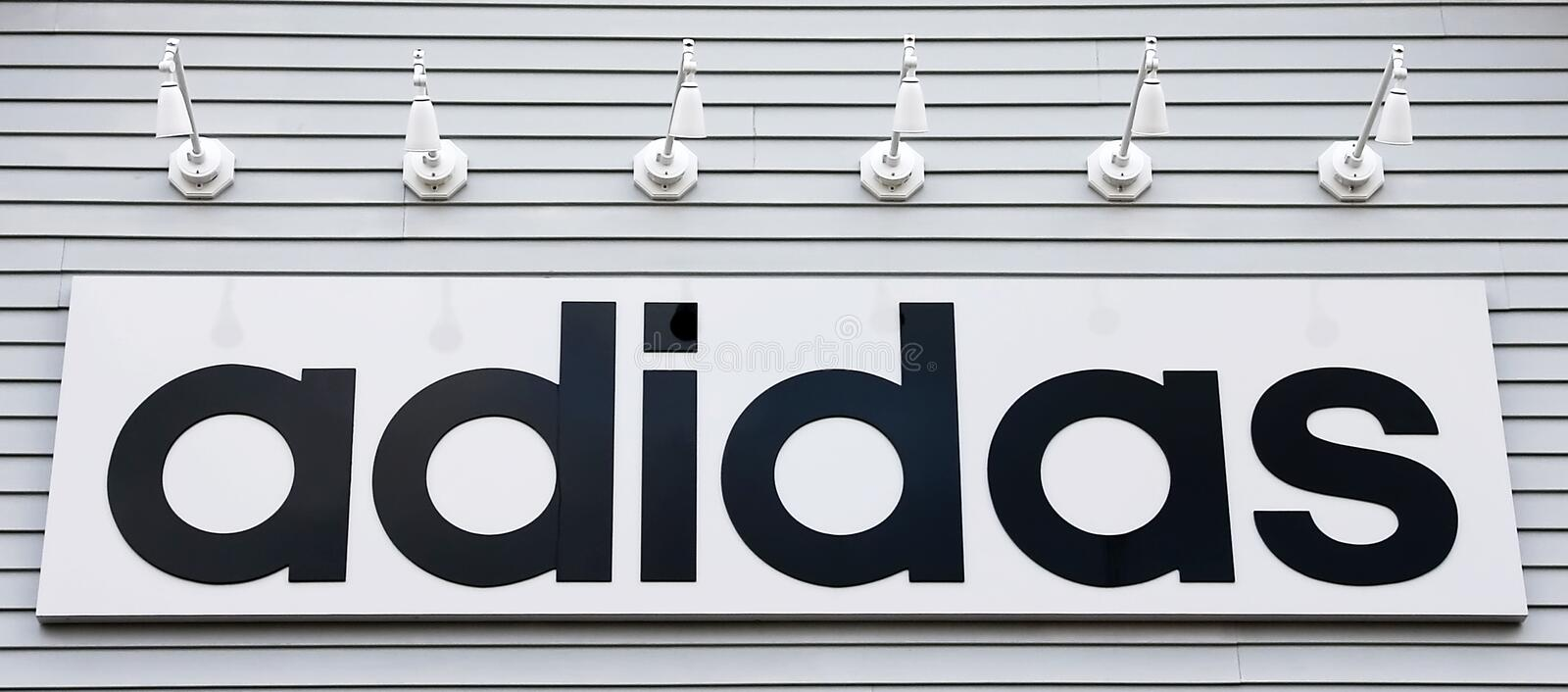 Sign adidas on the building royalty free stock image