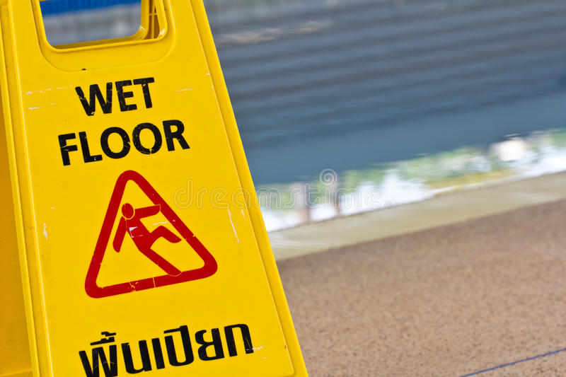 Sign advising caution. On wet floor stock photography