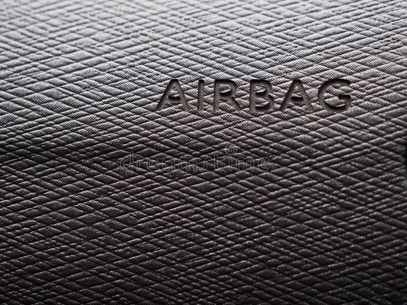 Sign of the airbag on the gray panel cars. royalty free stock image