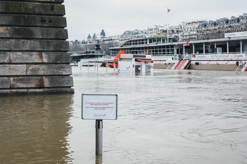 Sign announcing the cancellation of cruises due to raised water levels of River Seine in Paris, France royalty free stock images