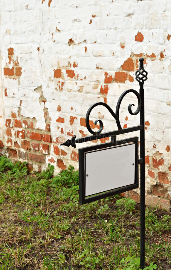 Download A Sign On The Background Of The Brick Wall Stock Photo - Image: 31010838