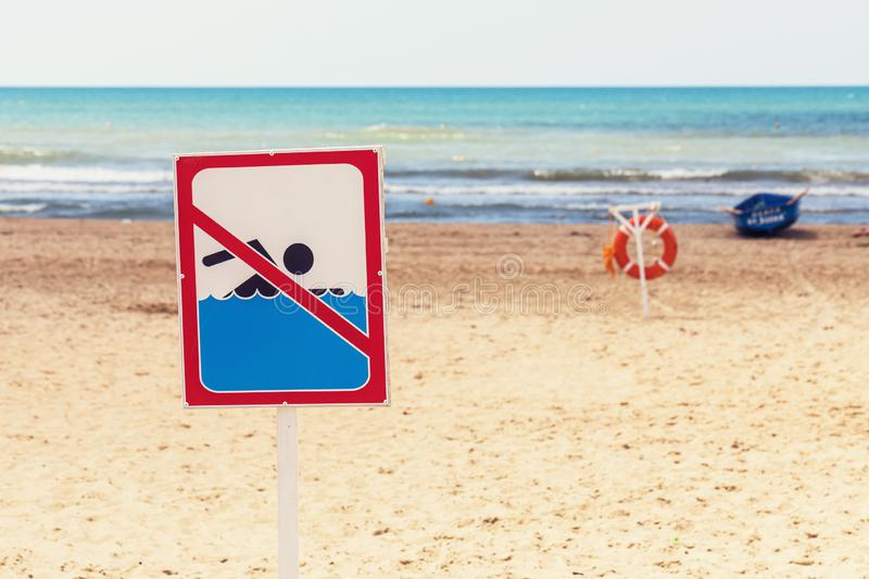 Sign on the beach prohibiting swimming in the sea. Sign on the beach prohibiting swimming in sea royalty free stock photography