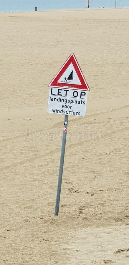 Sign on the beach of Scheveningen to warn for landing of kite and wind surfers at that spo stock images
