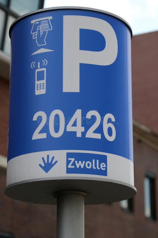 Sign in blue and white of the municipality of Zwolle to indicate the parking zone for payment per telephone in the Netherlands stock photography