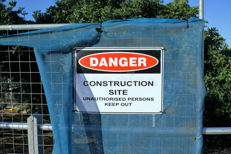 Sign board `Danger Construction Site Unauthorised persons keep out` stock images