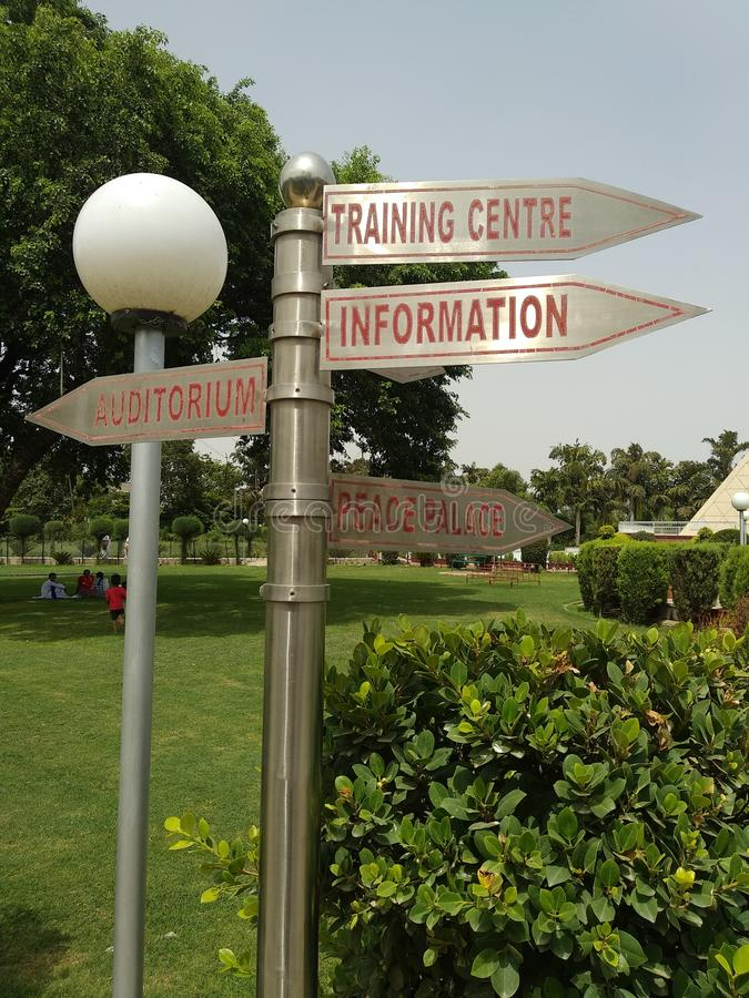 Sign board in a park for directions. stock images