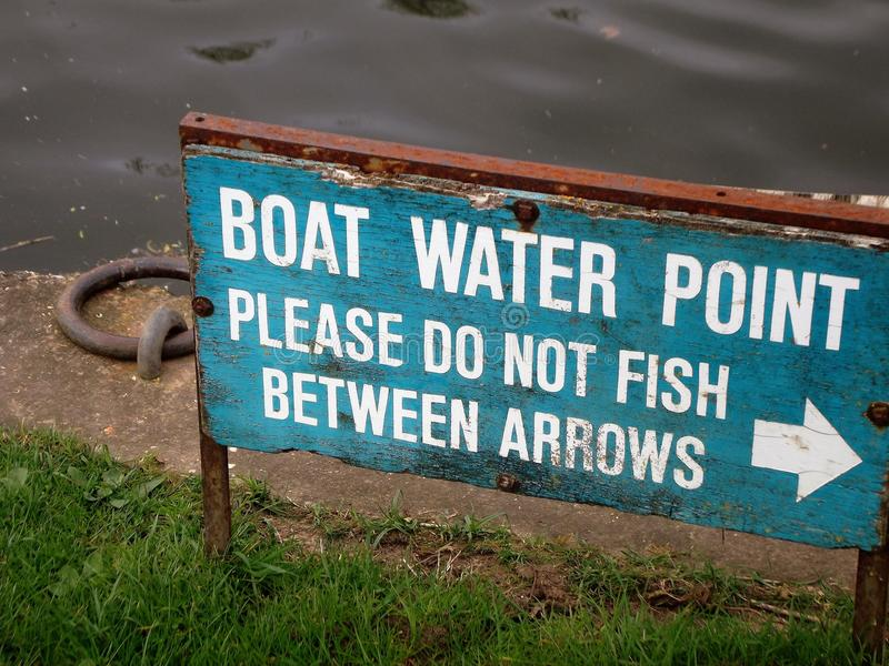 Sign. Boat water point please don& x27;t fish between arrows royalty free stock images