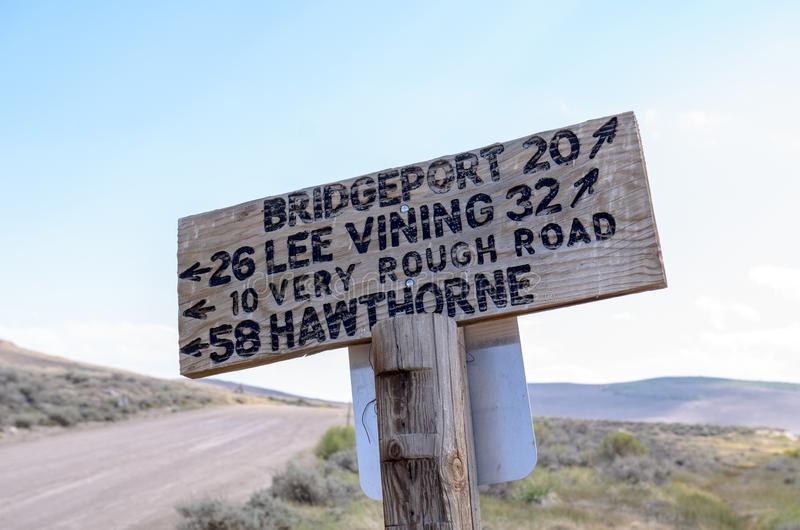 Sign from the Bodie Ghost Town road, giving drivers directions to local towns of Lee Vining, Hawthorne and Bridgeport California.  royalty free stock image