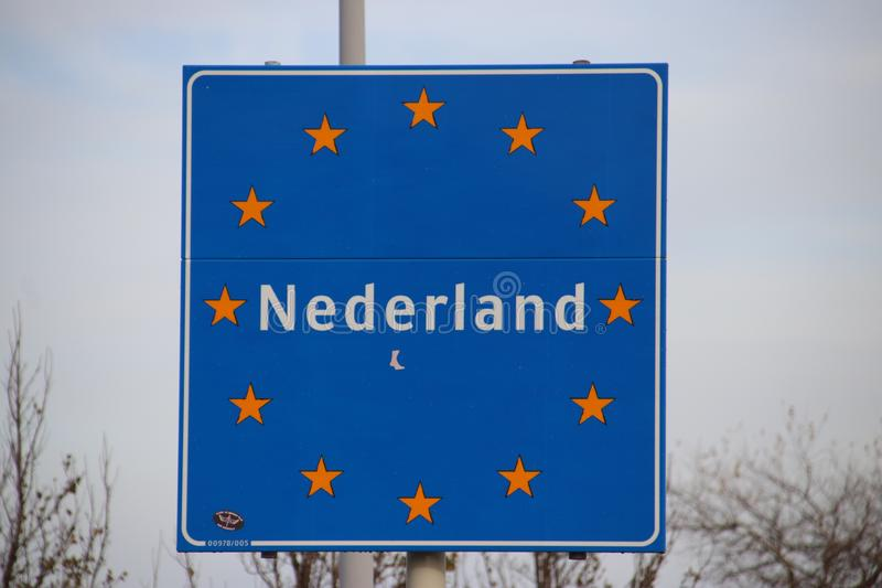 Sign at the border of the Netherlands with european stars and name Nederland in it. stock photos