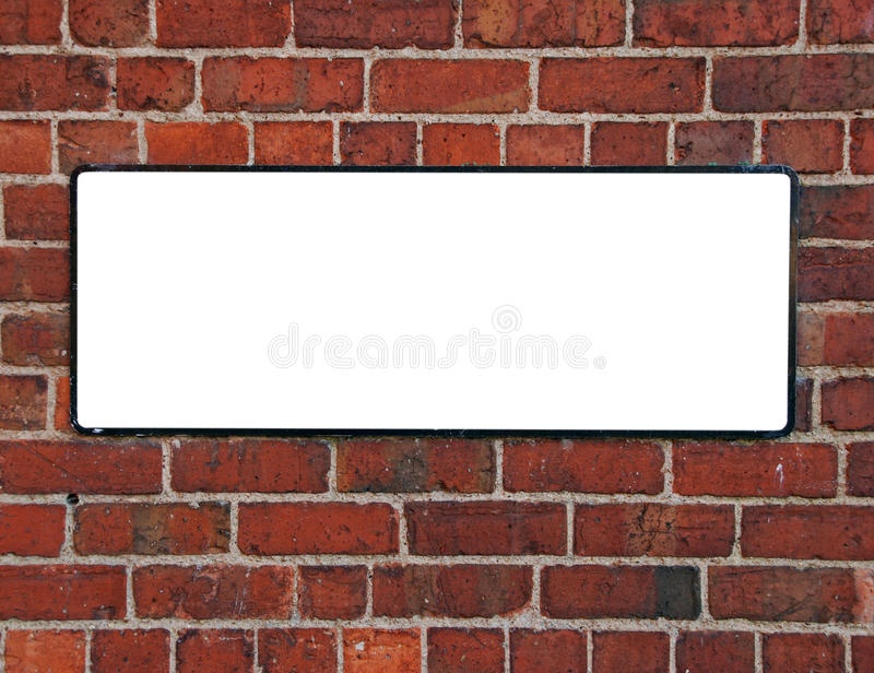 Sign on a brick wall