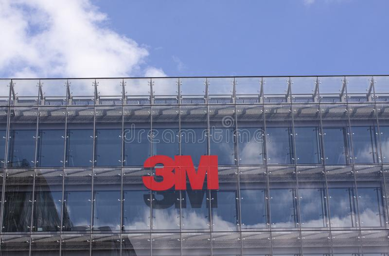 Sign on building facade with the logo of The 3M Company. American multinational conglomerate corporation. stock photography
