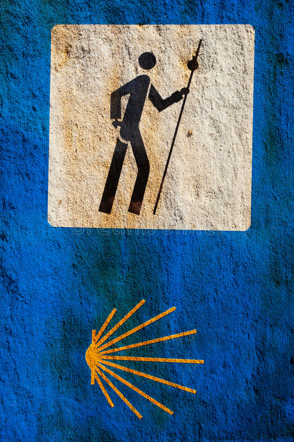 Sign of the Camino de Santiago. Over stone. Pilgrimage route to the Cathedral of Santiago de Compostela, Spain royalty free stock images