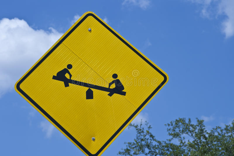 Download Sign - Children On TeeterTotter Stock Photo - Image: 20796730