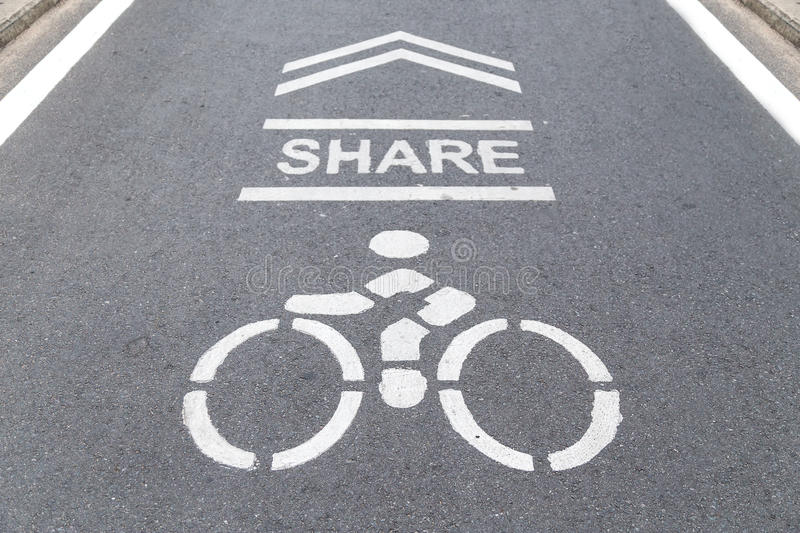 Sign on the cycling way meaning please share bike lanes for bike stock photo