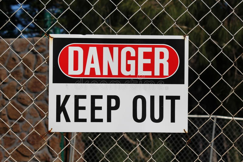 Sign DANGER. KEEP OUT on the fence royalty free stock photos