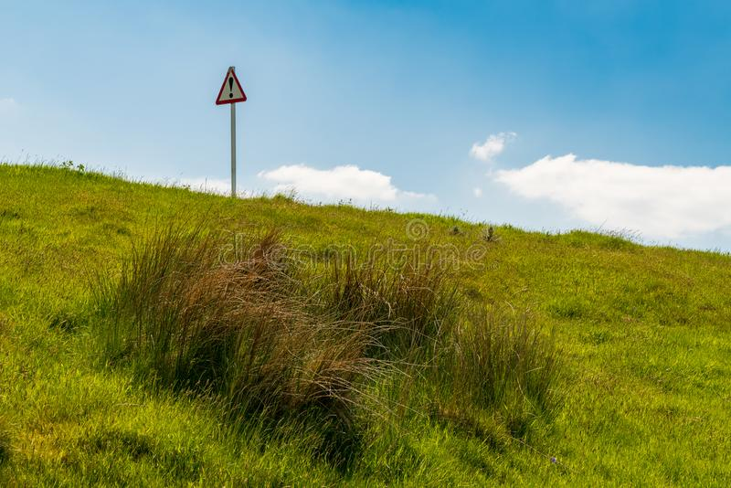 Sign: Danger Symbol. Sign: Danger, seen on the Panorama Walk, near Aberdovey, Gwynedd, Wales, UK royalty free stock images