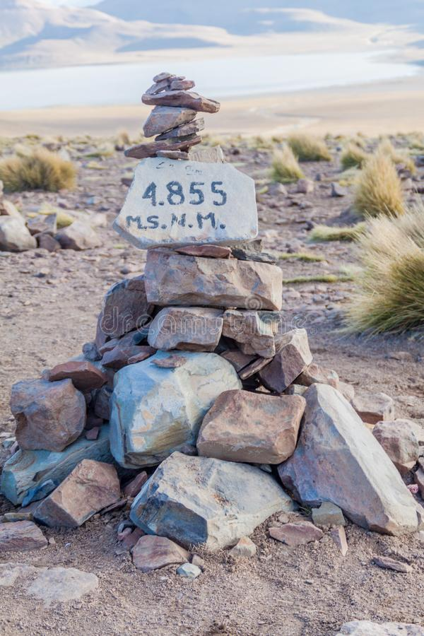 Sign depicting an altitude of 4855 meters. High pass at bolivian altiplan royalty free stock photos