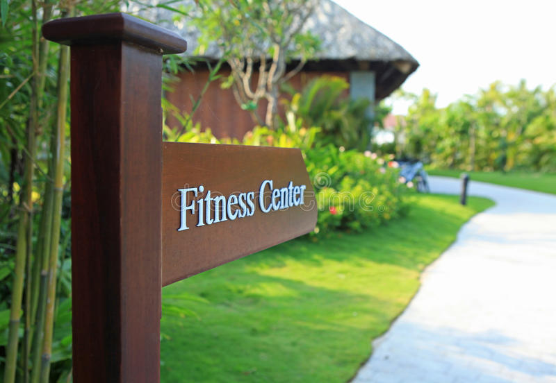Sign of direction to fitness center of a resort and spa. Sign of direction to fitness center of a luxury resort and spa royalty free stock photos