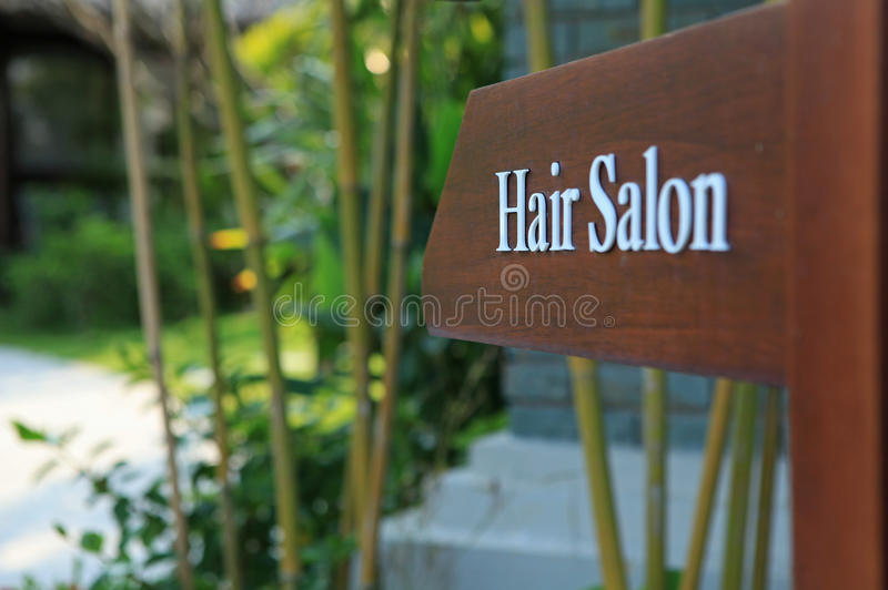 Sign of direction to hair salon in a hotel, resort and spa. Sign of direction to hair salon in a luxury hotel, resort and spa stock photos