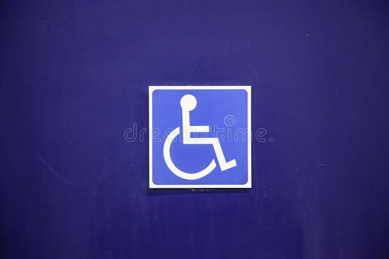 Sign for the disabled. Detail of information stock photography