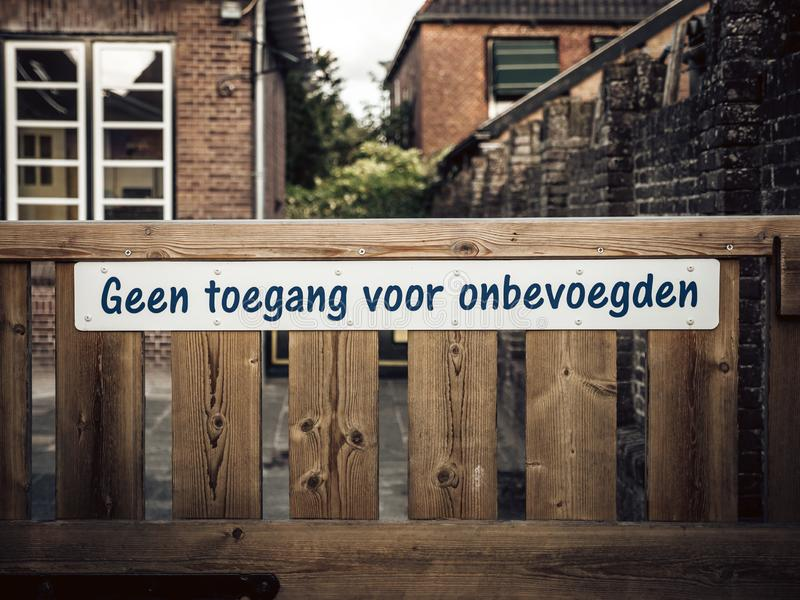 Sign with the Dutch text `no access for unauthorized persons` royalty free stock image
