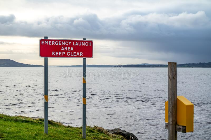 Sign Emergency launch Area Keep Clear in Buncrana - Ireland.  royalty free stock photography