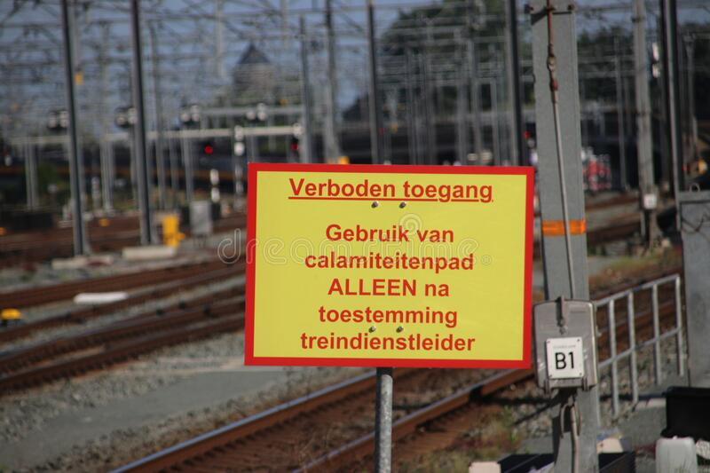 Sign on the end of platform of Utrecht Central train station that usage of small path is only allowed with permission of train ser stock images
