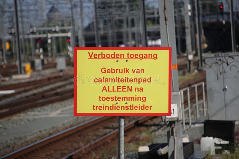 Sign on the end of platform of Utrecht Central train station that usage of small path is only allowed with permission of train ser royalty free stock image
