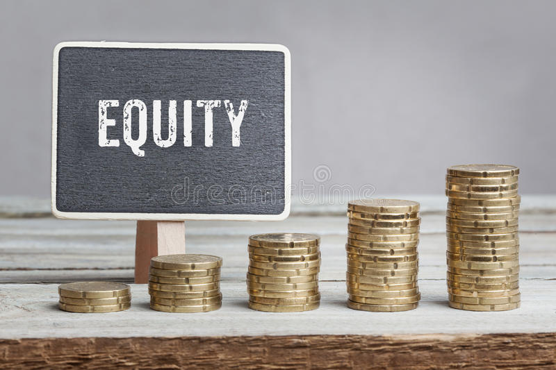 Sign Equity with growth coin stacks. Chalkboard/blackboard-sign, reading Equity in white font, five coin stacks of eurocents on grey background, increasing in stock images