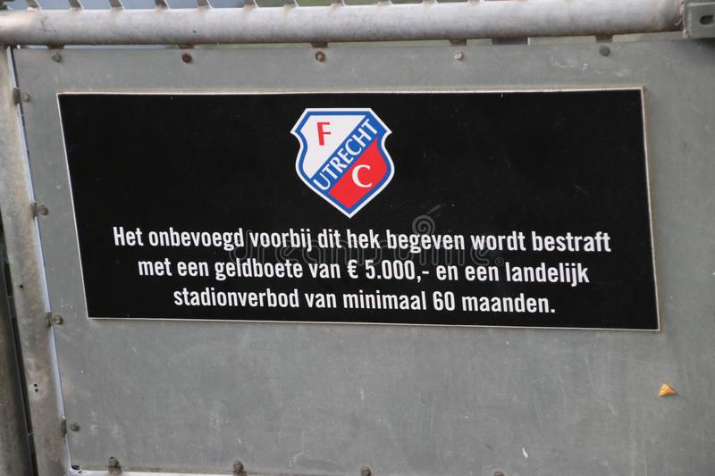 Sign in the FC Utrecht stadium that entering this fence and entering playfield royalty free stock photo