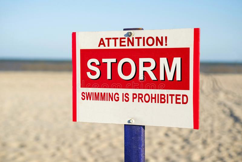The sign forbidding to bathe on the beach. Warning sign prohibiting swimming on the beach.  stock image