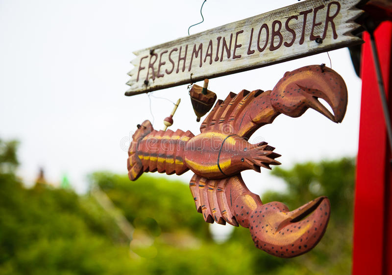 Sign for Fresh Maine Lobster. A wood hand painted and carved sign advertising fresh Maine lobster royalty free stock images