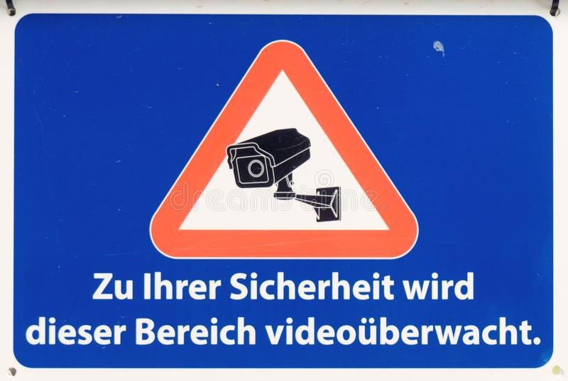 Sign with the German inscription: For your safety, this area is monitored by video.  stock images