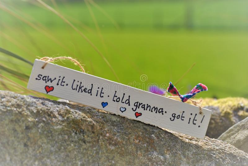 A sign for granma sitting on a wall waiting royalty free stock photography