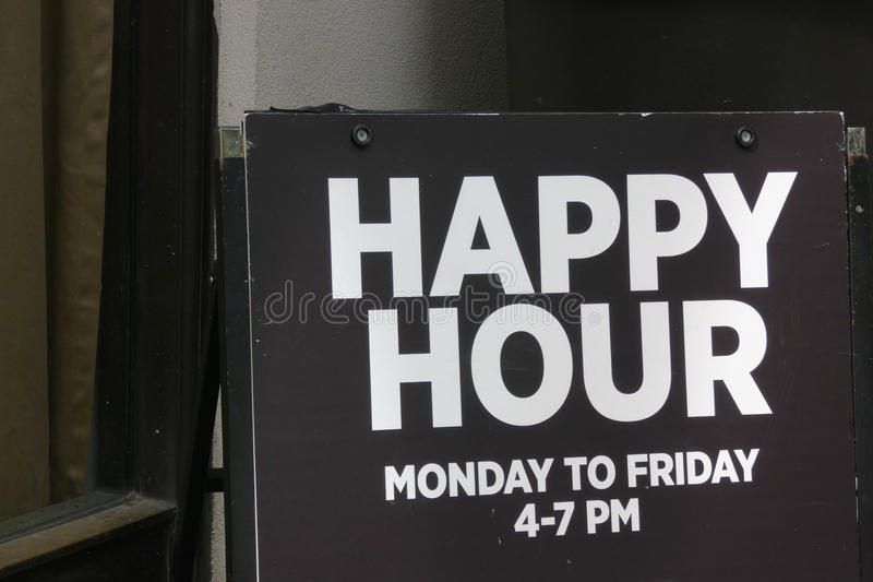 Happy Hour. A sign for Happy Hour outside a bar in New York City stock images