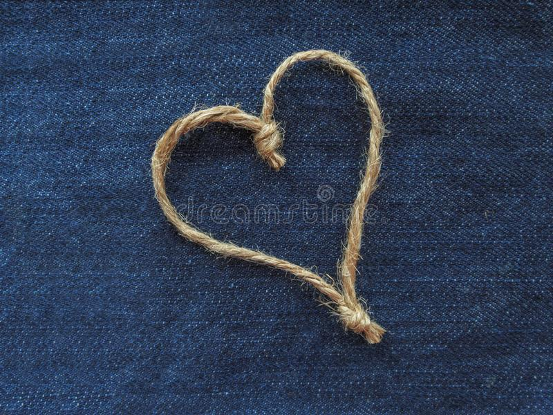 Sign heart of twine in denim stock photography