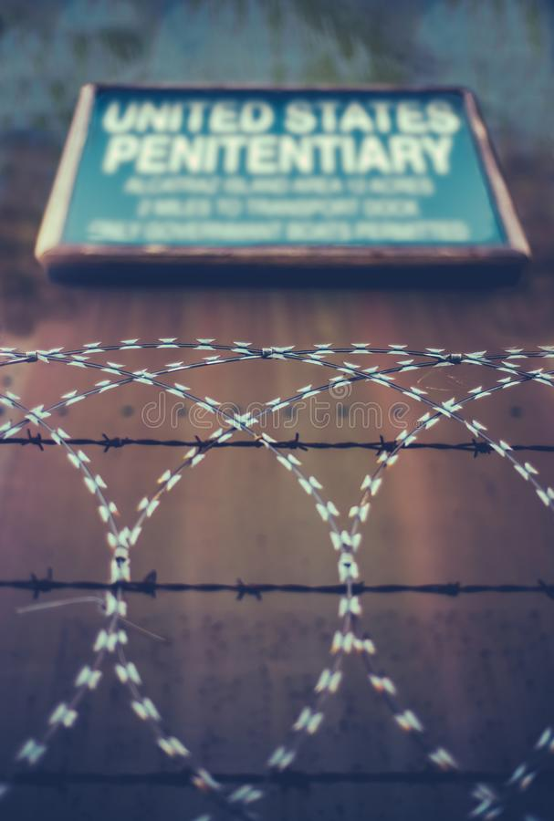 United States Penitentiary. A Sign For A High Security United States Penitentiary Or Prison Behind Razor And Barbed Wire royalty free stock image