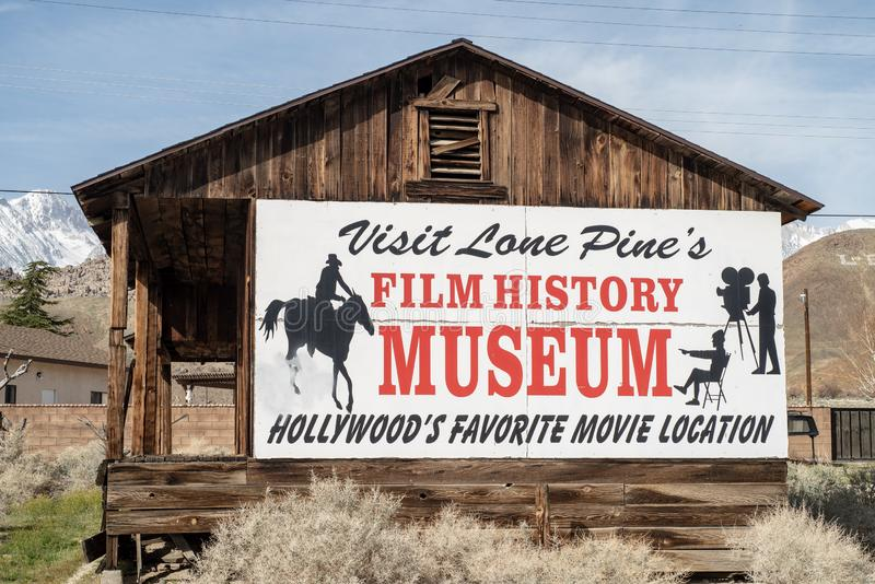 Sign for Hollywood Film History Museum painted on Western cabin Sierra Nevada Alabama Hills. Painted sign on side of wood western cabin for the Hollywood Film stock photo