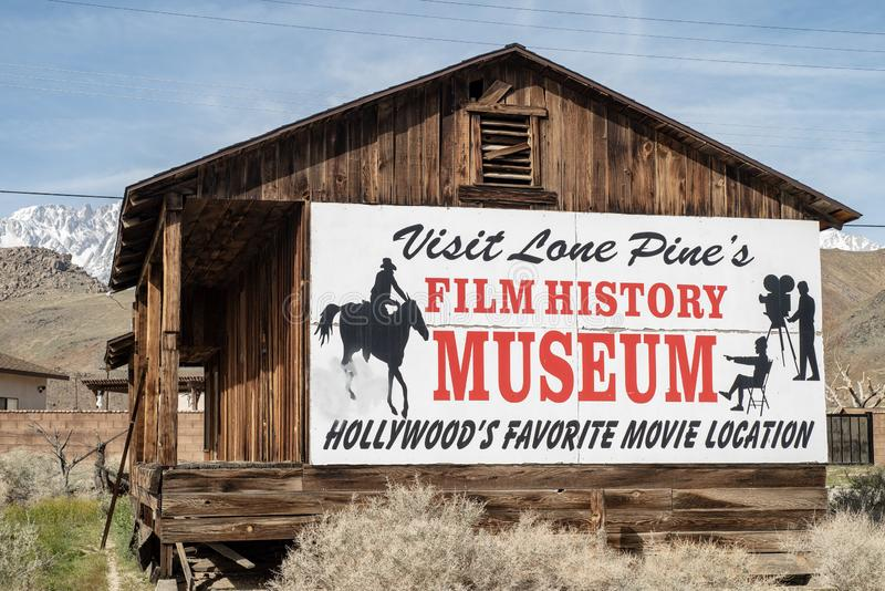 Sign for Hollywood Film History Museum painted on Western cabin Sierra Nevada Alabama Hills. Painted sign on side of wood western cabin for the Hollywood Film stock images