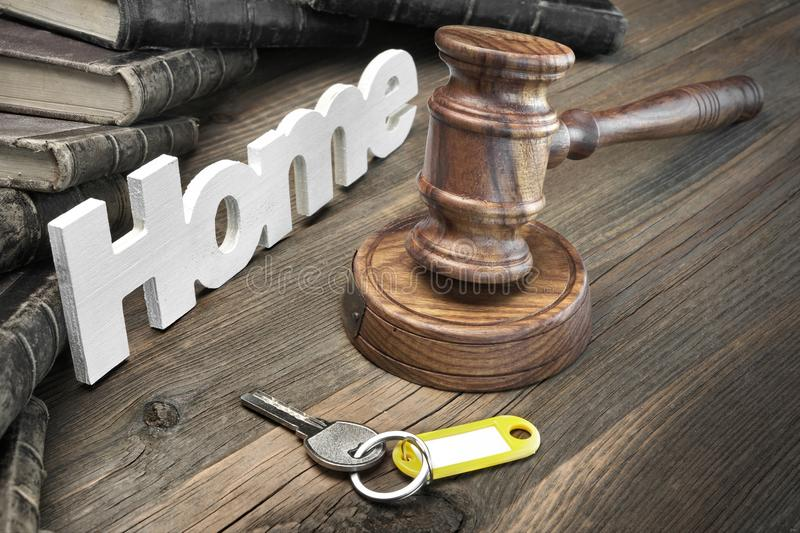 Sign Home, Key, Judges Gavel And Book On Wood Table. Sign Home, Door Key, Judges Or Auctioneer Gavel And Old Law Book On The Wood Table. Concept For Trial stock images