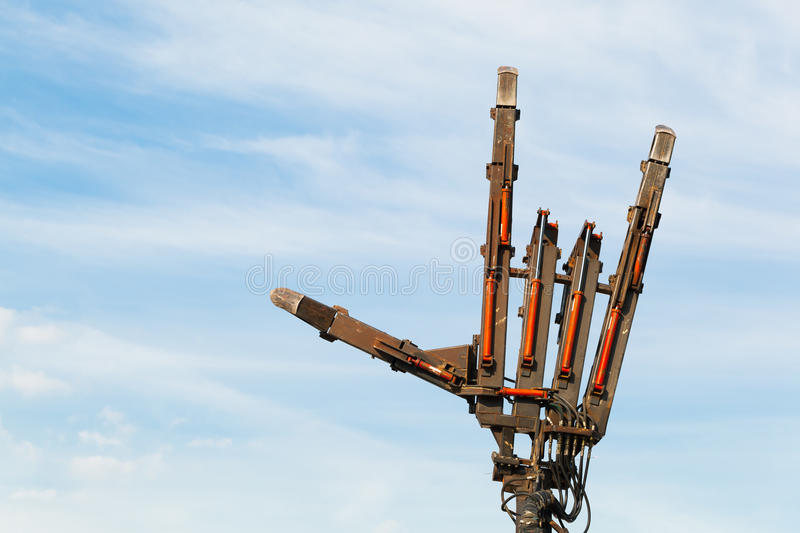 Sign of the horns made of metal pneumatic cylinders. Blue sky background stock image