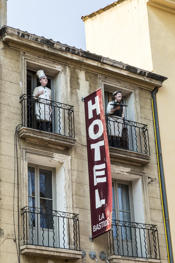 Sign Hotel at an old facade in red letters in Aix en Provence an stock image