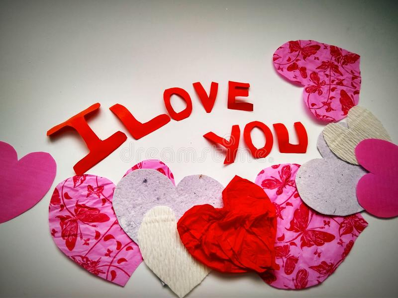 Sign I love you peper cut words. I love you peper cut words with white royalty free stock photo