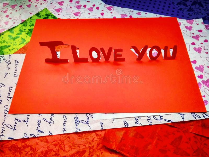 Sign I love you peper cut words. I love you peper cut words with white stock image