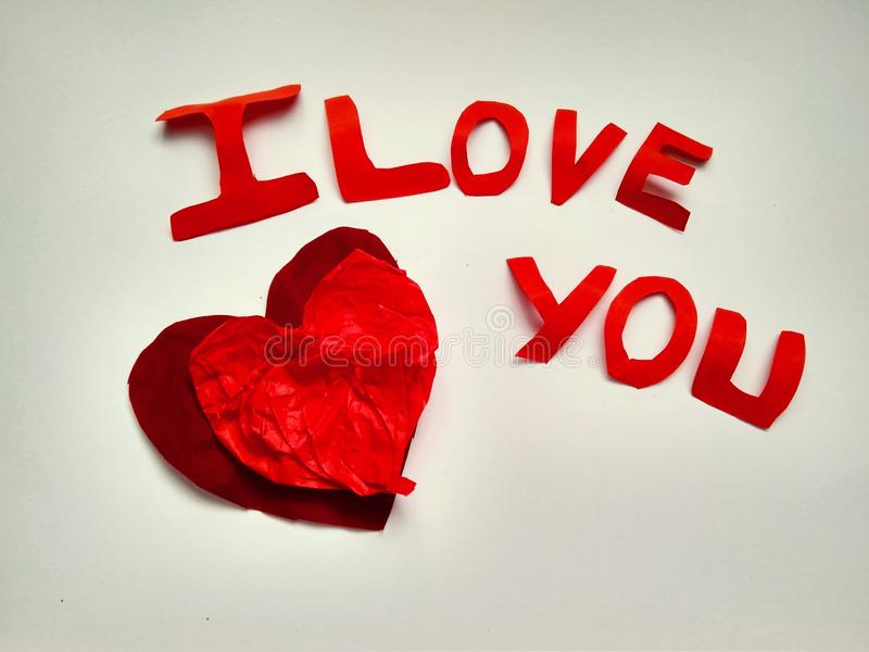Sign I love you peper cut words. I love you peper cut words with white stock photography