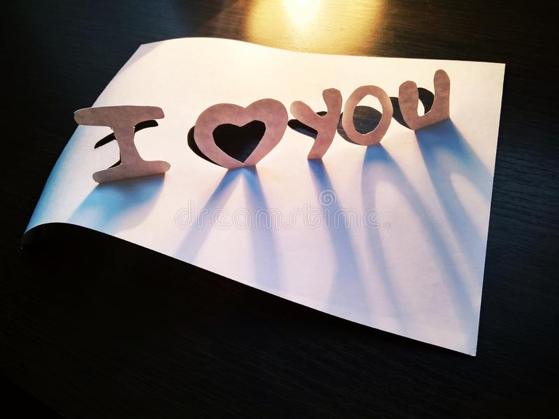 Sign I love you peper cut words. I love you peper cut words with white stock images