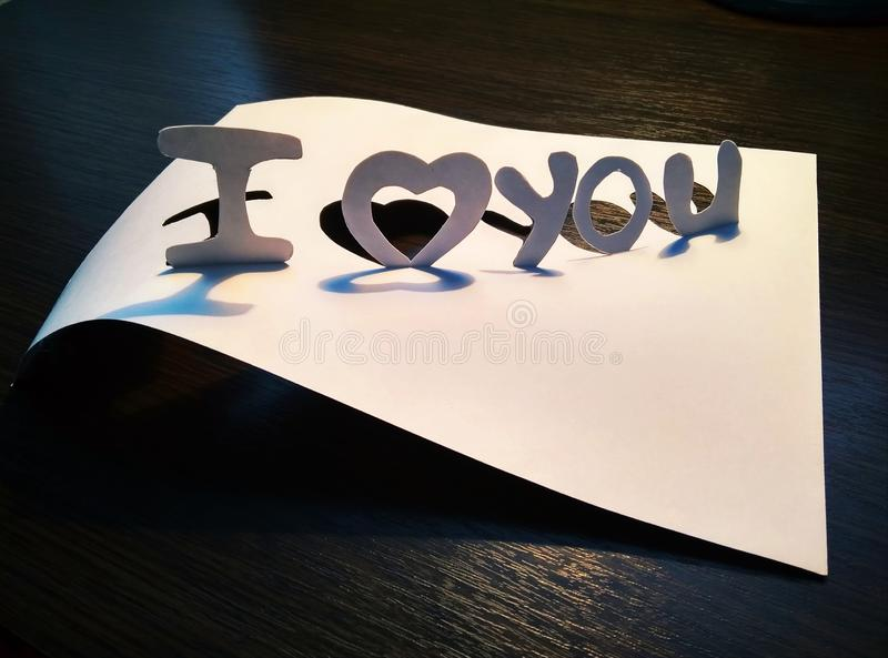 Sign I love you peper cut words. I love you peper cut words with white stock photos