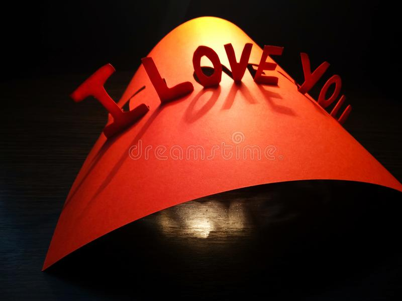 Sign I love you peper cut words. I love you peper cut words with white stock photo
