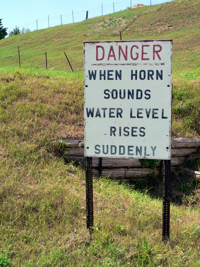 A Sign Indicates Danger On A Hill - When Horn Sounds Water Level Rises Suddenly Stock Images