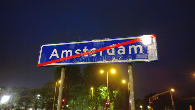 Sign indicating the end of the city of Amsterdam. Night city stock images